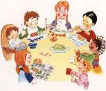 bambini che mangiano seduti intorno ad un tavolo