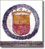 particolare di antico affresco con stemma civico
