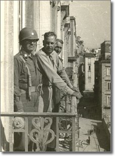 the brigadier general Frank J. McSherry at a balcony of Palace San Giacomo.