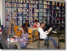 people reading in a library