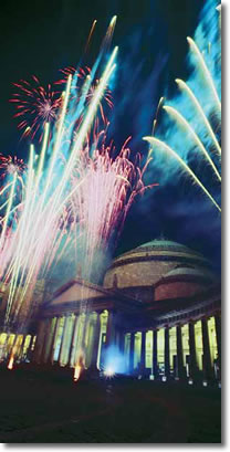night picture of the dome of S.francesco church in piazza plebiscito, with fireworks