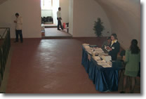 picture of the hall with hostess waiting for participants